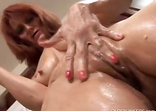 Sporty redhead MILF is getting naked