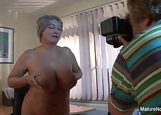 Busty short-haired MILF and a young man