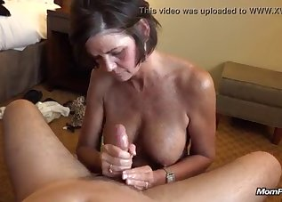 Stunning busty babe jerks off a big cock