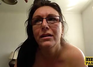 Inked mommy is playing with a big cock