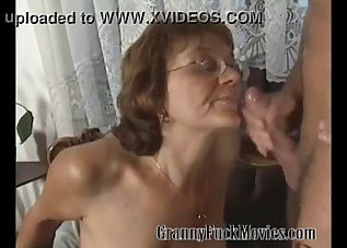An old lady is fucking with a younger man